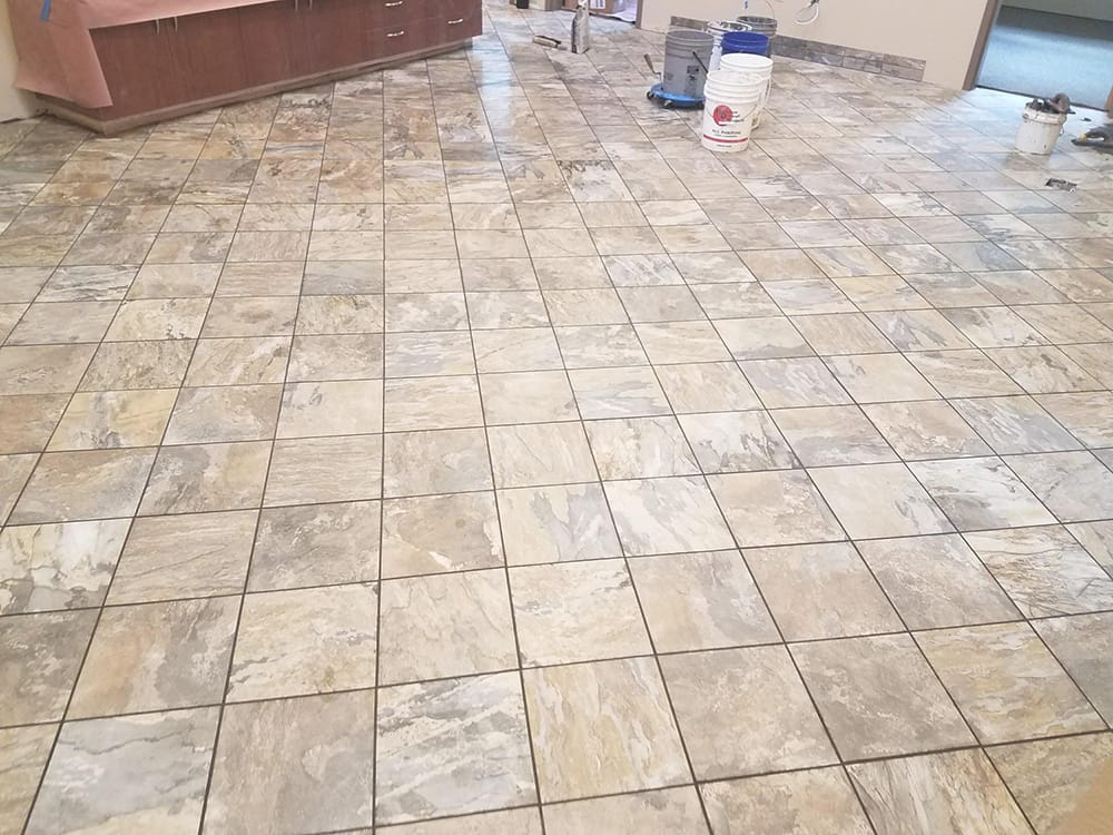 tile floor being maintained by carbonneau tile